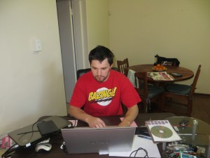 Ryan working hard at his desk.  Our apartment came fully furnished except for this desk.